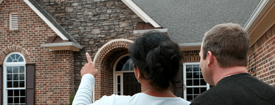 Couple Looks at new roof   Why Above All Roofing Over Other Roofing Contractors